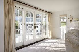 double french wood gliding patio doors with a white interior and colonial grilles in a traditional