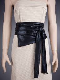 infinity belt. this beautiful and effective wide black belt is made of fabric. you can fasten it in different ways as an infinity