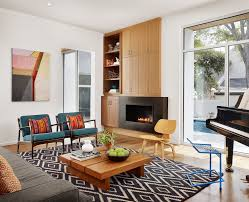 mid century modern rug Living Room Contemporary with armchair Art black  fireplace. Image by: Chioco Design