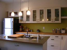 ikea lighting kitchen. Fabulous White Kitchen Cabinetry System With Modern Island Also Wooden Countertops As Inspiring Ikea Cabinets And Lighting Decors
