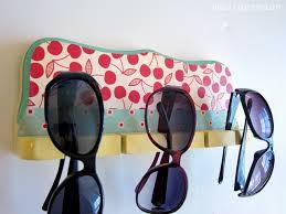 cute sungl holder from a fishing rod rack great idea to have near a pool for extra sungl for guests