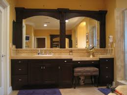framed bathroom mirror. bathroom ideas, two wood framed mirror with single sink vanity and small bench