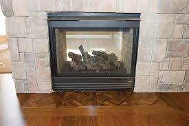 one detail that adds interest and value to a wood flooring installation is a picture framed fireplace