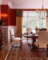A living room can serve many different functions, from a formal sitting area to a casual living space. Cozy Red Dining Room Persian Carpet Chair Rail Half Red White Wall Gold Curtains Better Decorati Dining Room Curtains Red Dining Room Dining Room Design Modern