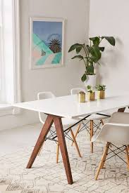 the saints dining table is a sleek midcentury modern dining table perfect for an intimate dinner or lunch setting paired with our truman chair in white modern white i62