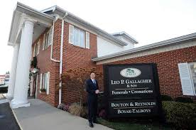 general manager christopher farrugio poses outside the stamford leo p gallagher son funeral home