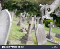 Grave Decoration Hand Of An Angel Holding A Flower Part Of A Grave Decoration At