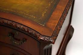 antique carved mahogany leather top