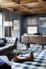 man office ideas. plaid carpet noguchi table chesterfield sofa masculine design stained wood ceiling rich classic man office ideas f