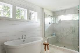 oval bathtub on shiplap wall