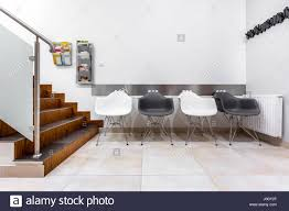 contemporary waiting room furniture. Modren Contemporary Modern Waiting Room With Stairs Black And White Chairs Glass Balustrade To Contemporary Waiting Room Furniture
