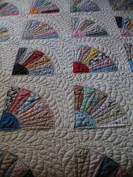 Pacific Patchworks: The 1930s Grandmother's Fan Quilt & I wish I would have taken a picture of a certain quilt block before machine  quilting it in continuous curves and feathers, because on the muslin fabric  ... Adamdwight.com