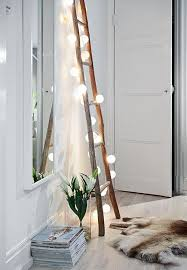 lighting in the home. this would actually be a really fun idea to bring light into the space ladder could go against wall where metal desk is now with string lights lighting in home m