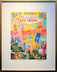 move your mouse over imagethe screen print is a collage of typical scenes you will see in las vegas the show girl and the cowboy and you can t forget about