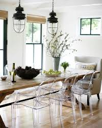 i love the style of this dining room it s modern with a rustic country twist not a big fan of the clear chairs photo by belathee photography via rue