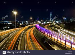 Night Light Auckland Light Trails Leading Into Auckland City At Night Stock Photo
