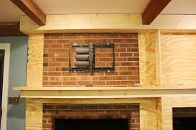 the handcrafted life the finale to building a fireplace can you mount a tv on a brick fireplace wall can you mount a tv on a brick fireplace wall