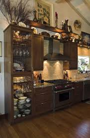 decorating above kitchen cabinets stunning how to decorate the top of a wall unit
