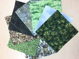 Making a fractured landscape quilt using a simple piecing method & Nature looking fabric on table Northcott Fabrics Adamdwight.com