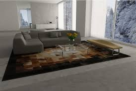 square tiles brown beige and black leather area rug in an open loft