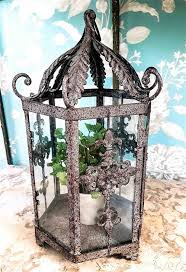 a french provincial style rustic indoor outdoor decorative lantern with glass panels and faux pot plant h 41 x w 25cm