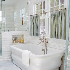 window curtain panels near a bathtub or shower