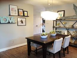 modern concept simple dining room design with dark wood table and white chairs with simple wood