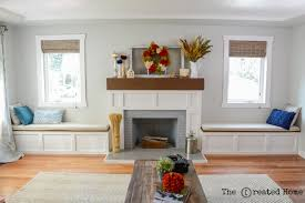 custom diy fireplace wrap craftsman style build in window benches with storage reclaimed wood mantle