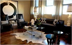 small white and black cowhide rug living room decoration idea square glass on top with chromed iron legs coffee table leather velvet fabric modern cushion