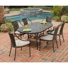 Stone harbor 7 piece oval patio dining set with taupe cushions