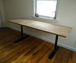 custom modern butcher block computer desk with black metal legs under window for small home office spaces with hardwood floor tiles ideas black metal computer desk