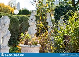 direction of travel europe a garden full of sculptures flowers and trees in a italian restaurant in germany