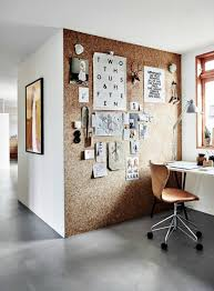 cork feature wall in home office with built in desk