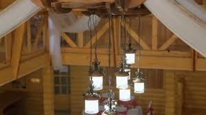rustic chandelier on the high ceiling in a wooden house chandelier with chain stock