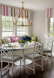 bamboo dining chairs. Pink And Gray Kitchen Dining Space Features Boasts Windows Dressed In Striped Roman Shades Framed By Walls Positioned Behind To The Bamboo Chairs