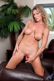 Totally nude Anilos milf Jade flaunts her curvy body while.