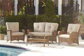 cosco outdoor s cosco outdoor 4 piece lakewood ranch steel woven wicker patio furniture conversation set with cushions and coffee table