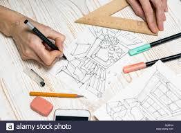 Interior Design Calculator Interior Designer Working On A Sketch Background Drawing