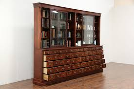 apothecary or antique cabinet 60 drawers sliding glass doors