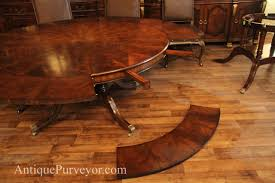 mahogany perimeter leaf table with leaf shown on floor to ilrate assembly