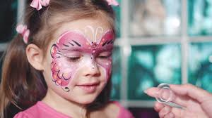 painter hand draws face painting to little aqua makeup child with funny face painting um close up stock video fooe storyblocks video