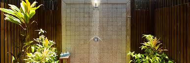 stylish and modern outdoor shower surrounded by tropical garden