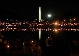 photos of and the days after thousands of people take part in a candlelight vigil on the national mall in washington d c