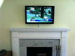 hanging tv above fireplace above fireplace wires enter image description here mounting above gas fireplace hiding