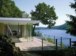 Modern German House Clad in Glass Offers Unabated Lake ViewsView in gallery Deck space outside the Lake House