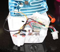 how to install a frigidaire electrolux cold control kit to a once the control box is removed the defrost timer needs to be unscrewed the control box the defrost timer is the only thing in the control box that is