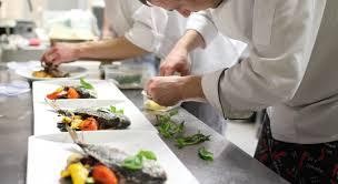 busy restaurant kitchen. Busy Chefs At Work In The Restaurant Kitchen