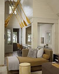 living room carolina design associates: beach house foyer beach house foyer with boat oars on ceiling beachhouse hickman design associates