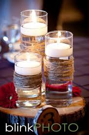 Another floweless idea, floating candles amd twine in your wedding colours