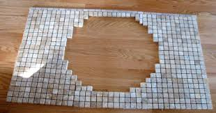tiling ideas bathroom top: score the vanity top with a box cutter or a knife the reason we do this is so that the glue will have something to grab onto